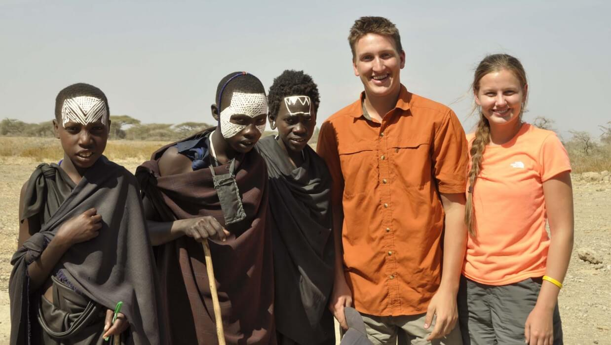 group of travels with local african villagers